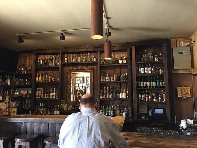 A shot of the bottles behind the bar at Cantina Mayahuel