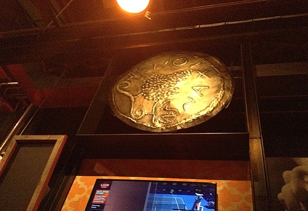 Giant ancient Greek coin reproductions revolve above your head