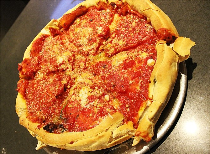 Stuffed-crust, Chicago-style deep-dish pizza from Regents Pizzeria