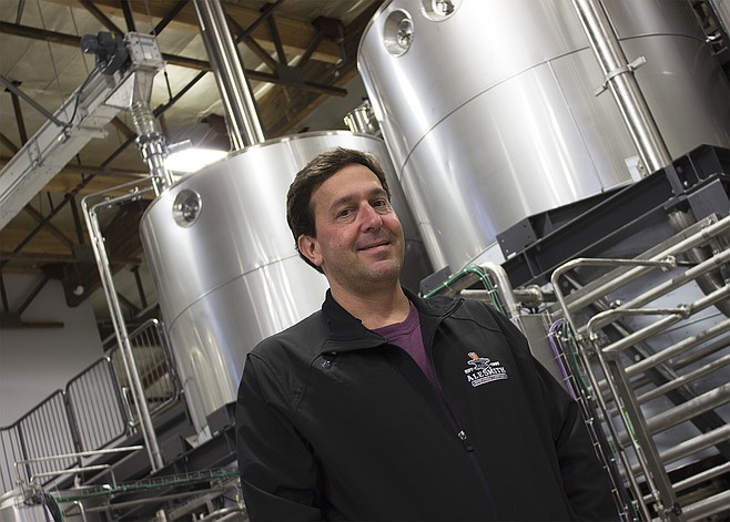 "AleSmith owner and brewmaster Peter Zien in front of his ""Rolls Royce of brewhouses"""