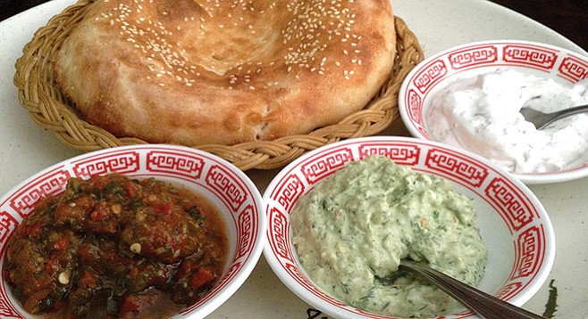 Free appetizer! Fresh tandoori-baked bread with three sauces