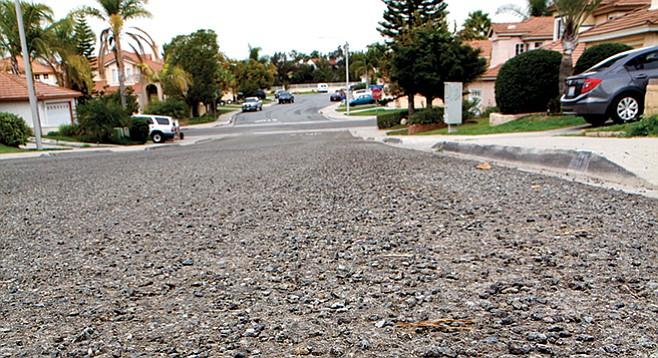 Asphalt turning to gravel on Via Armado in Chula Vista