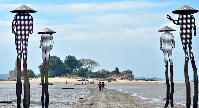 Low-tide path leads to an island beach in Kinmen, Taiwan.