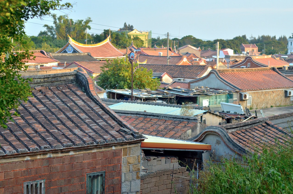 Village rooftops from a hill.
