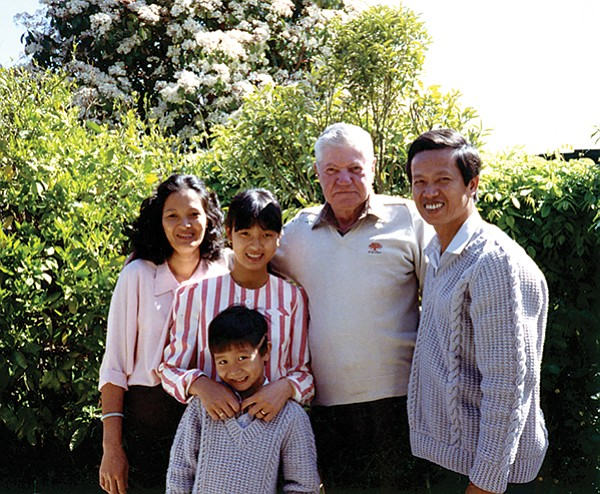 Tam and his family with his uncle Frank (second from right).  I saw just how much of a difference knowing English made. My uncle was comfortable, in control, conversing with his hands. My dad stood to the side, hands still, smiling a sheepish grin.