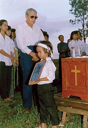 Tam at his brother's funeral
