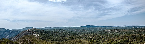 The panorama taken from Monument Peak shows the escarpment drop into the desert from the forested Laguna Mountains.