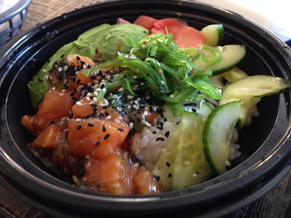 I dig the cucumber and avocado. Salmon Poke Bowl. Fish District.