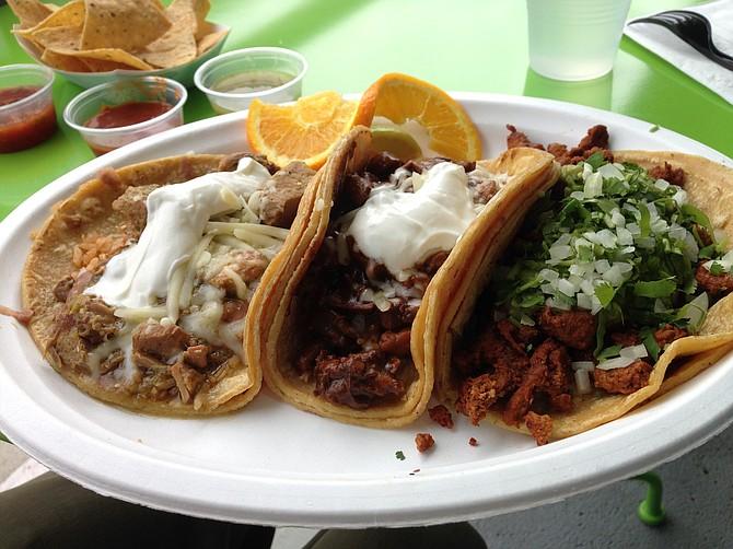 A sampling of tacos: Chile Verde, Mole Poblano and Adobada. Amorcito Corazon.