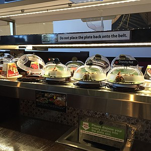 The conveyor belt, Mr. Fresh-contained sushi, and plate slot