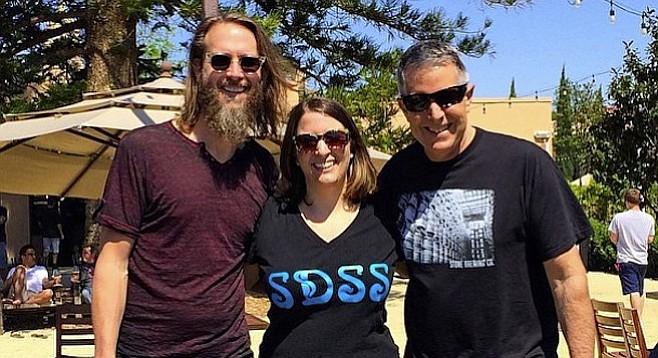 Juli Goldenberg, flanked by Stone co-founders Greg Koch (left) and Steve Wagner