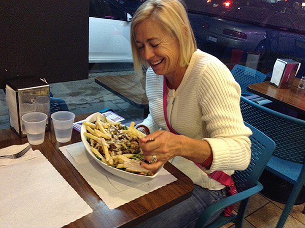 Cindy laughs at the size of her chicken shawarma salad