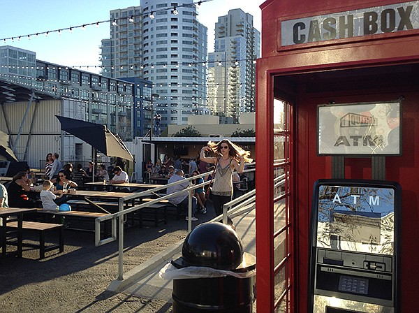 English phone booth ATM in front of the Quartyard bar