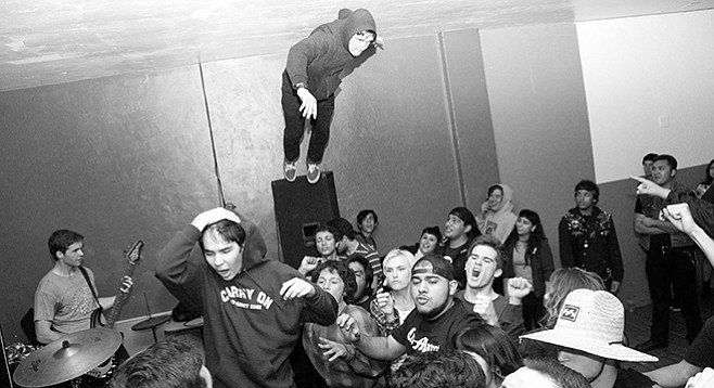 Noah Prescott conducts stage-diving lessons at LGP shows. - Image by Daniel Rodriguez (negativedensity.com)