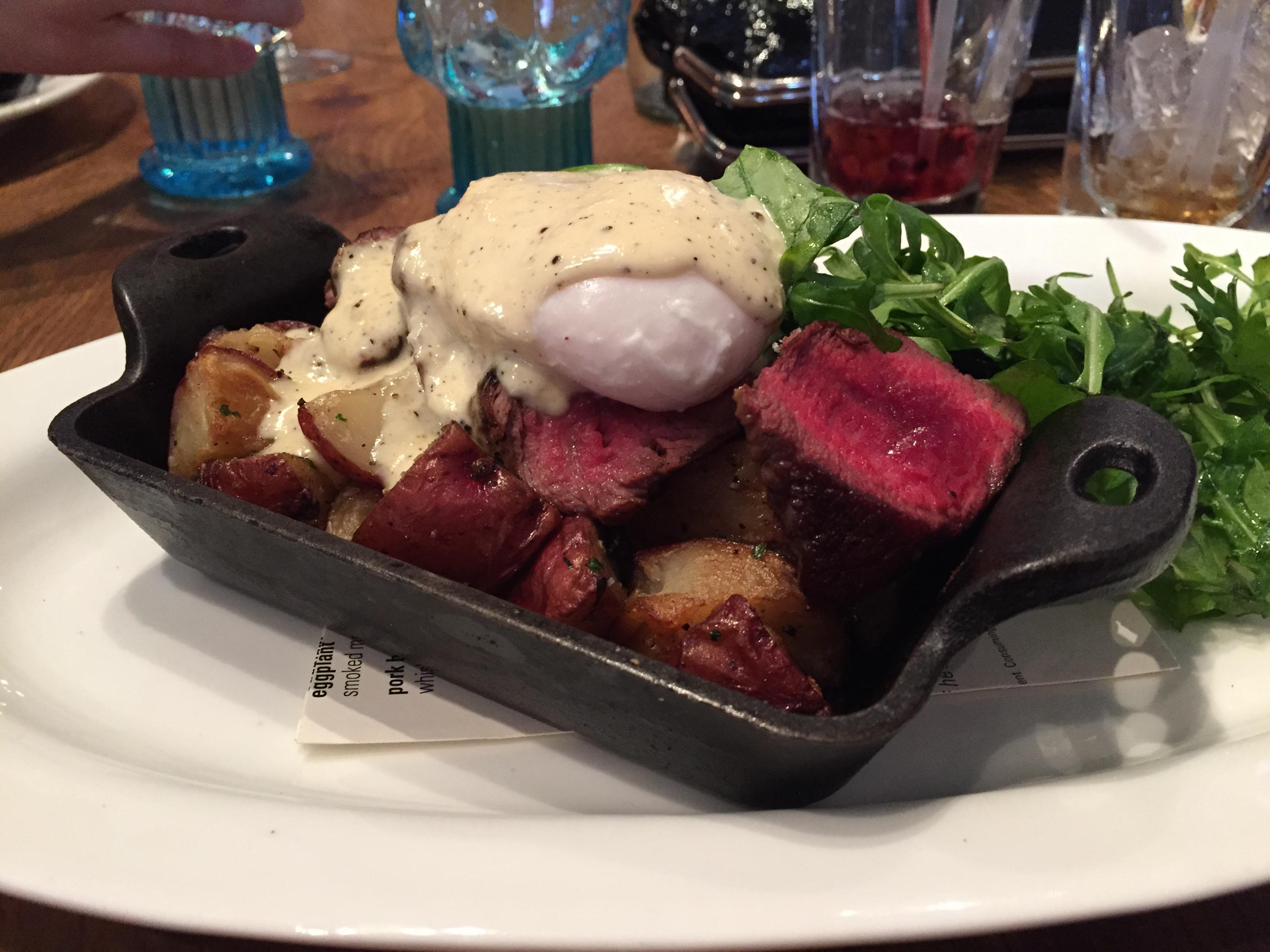Cowboy Steak with eggs, potatoes, and horseradish-black pepper hollandaise