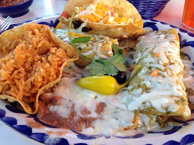 The #2 combinacion: taco, tamale, and enchilada with rice and beans. Everything topped by loads of cheese.