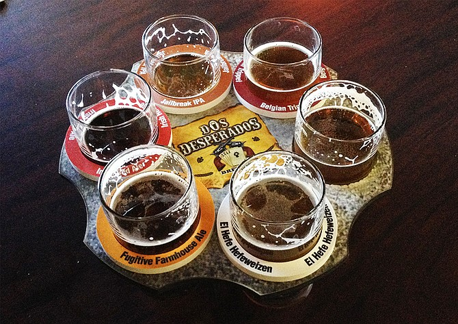 A six-shooter of beers at Dos Desperados Brewery in San Marcos (photo by @sdbeernews)