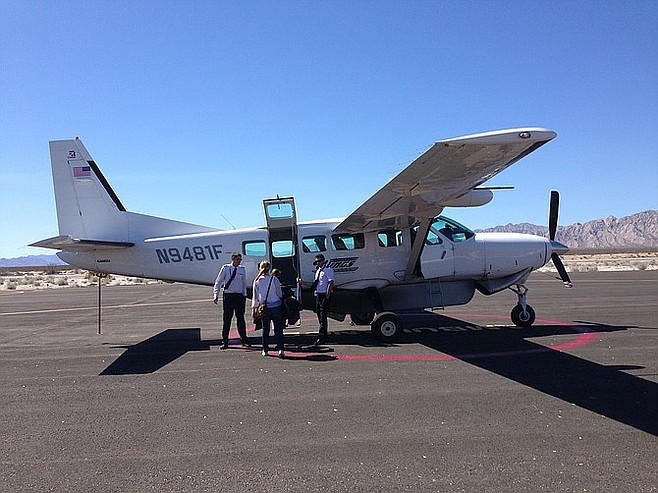 Boarding the 9-passenger SeaPort Airlines plane.