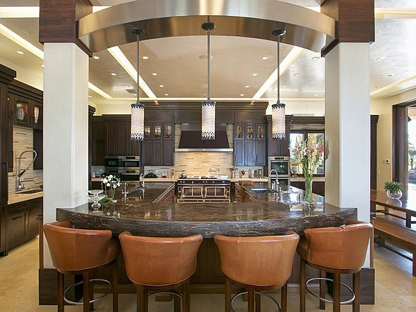 """Kitchen includes """"hand pounded stainless steel sinks"""""""