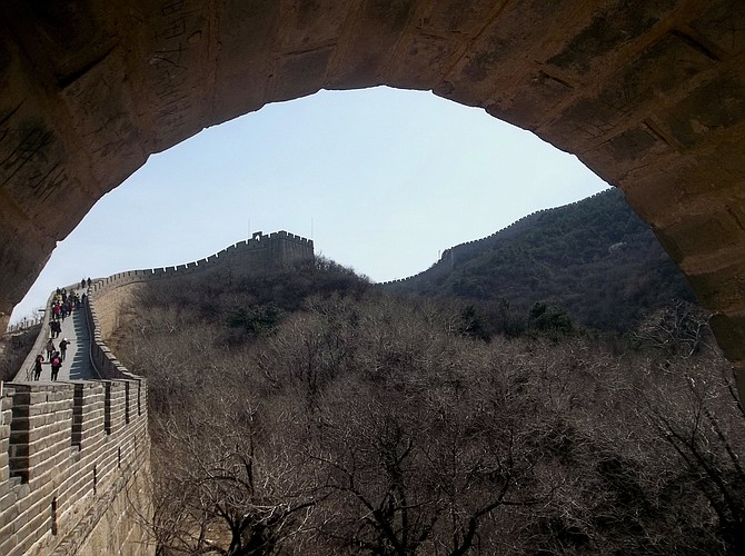 Peering through an arch at the Great Wall of China