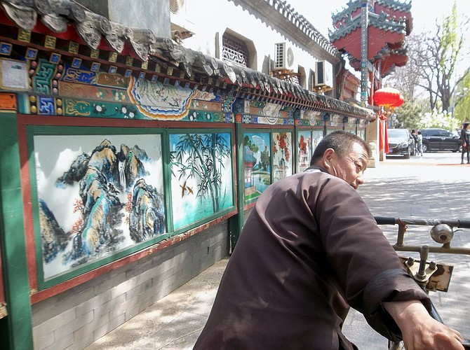 Rickshaw ride through Beijing's hutongs