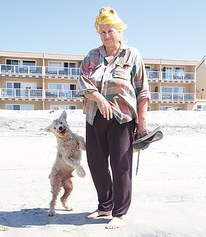 Rina Kelley and her dog Sparky were attacked by an unleashed pit bull on the sand at Imperial Beach.