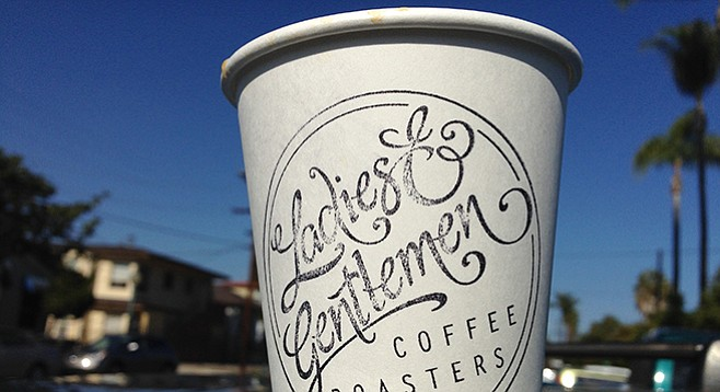 A hand-stamped cup of Ladies & Gentlemen coffee at Golden Hill farmers' market.