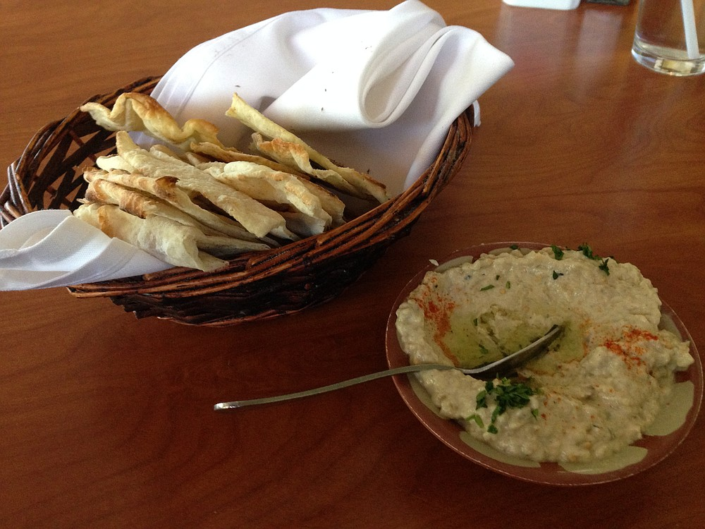 Baba ghanoush and a basket of fresh flat bread