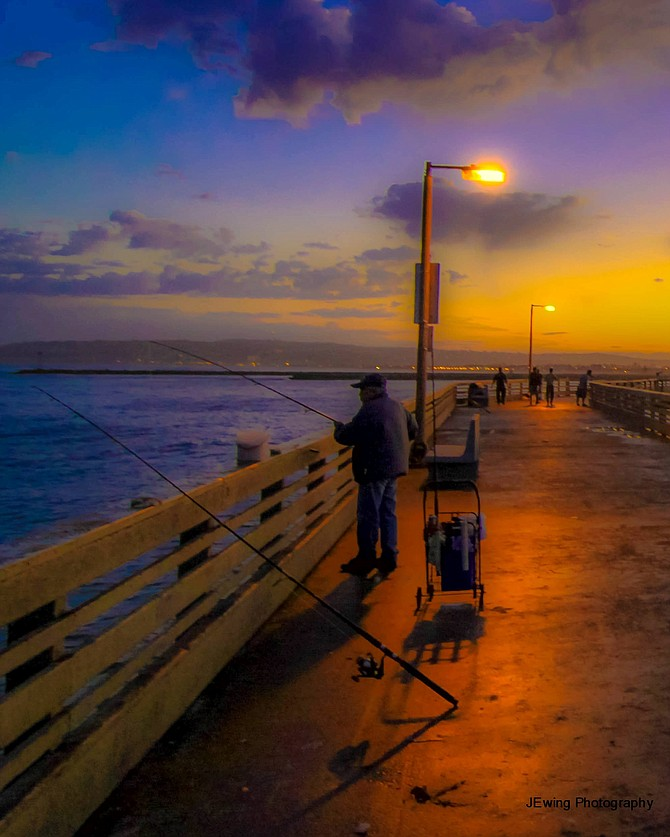 Fisherman on the OB Pier at dawn