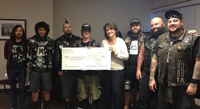 DIY show promoters the Pyrate Punx present a big check to local autism chapter.