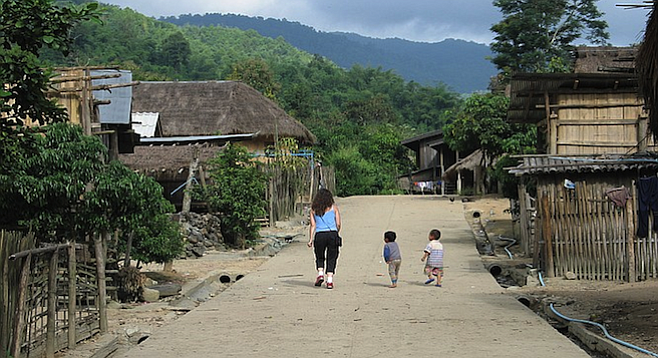 Making friends in Lahu village (finally), about 15 miles outside of Chiang Rai.