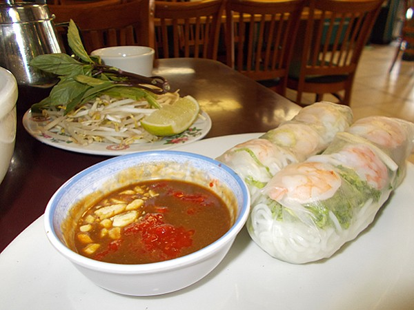 Chili-peanut sauce and spring rolls stuffed with shrimp, pork, bean sprouts, mint, lettuce, and chives.