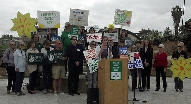 Arin Zwonitzer, backed by other opponents of SDG&E's proposed  gas-fired power plant in Carlsbad.