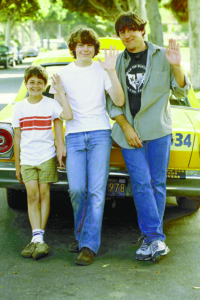 Michael Angarano, Patrick Fugit, and Cameron Crowe on the set of Almost Famous. The movie strikes me as insufferable dogmeat.