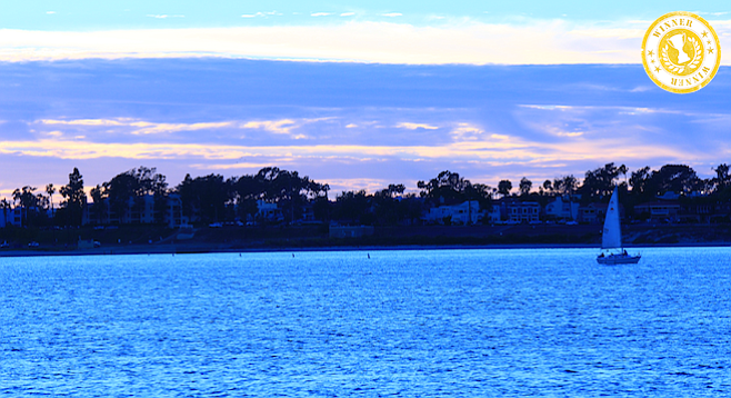 Looking out on a tranquil Mission Bay at dusk.