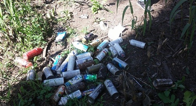 Spray-paint cans littered by graffiti artists at Adobe Falls