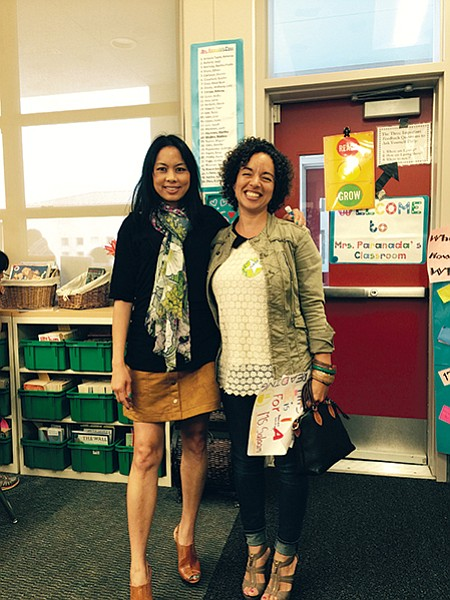 Elizabeth (right) with the fourth-grade teacher