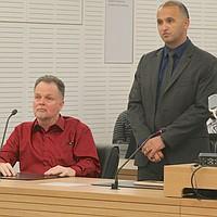 Merritt w potential attorney Jimmy Mettias. Pool photo by John Gibbins