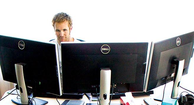 Bryce Daifuku's online poker monitors in his dining room