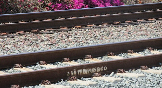 More visible signs won't deter those who are going to cross the railroad tracks!
