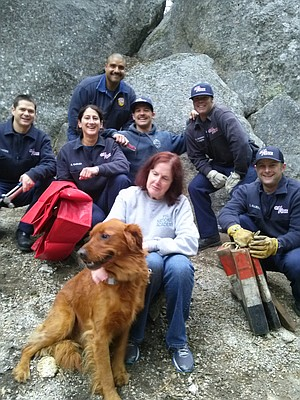 Cal Fire rescue crew and Sara Norris with Aslan