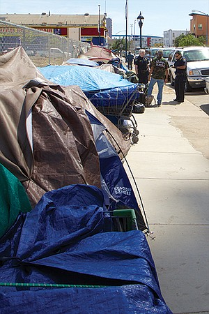 """""""Before"""" photo of wall of campers across the street from the new Pinnacle high-rise."""