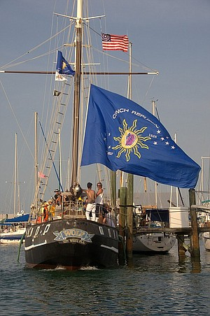 The rebel ship Wolf flies its colors in Key West.
