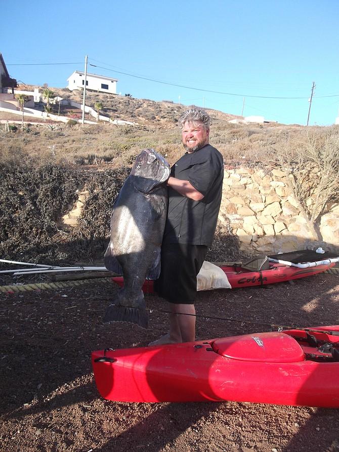 "Christopher Maggio with a 54"" black seabass, San Quintin, Mexico"