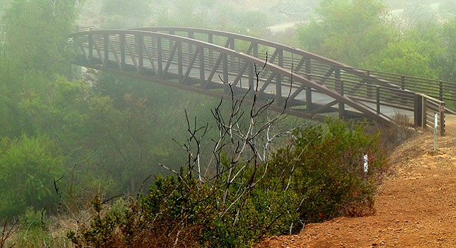 An iron bridge spans Del Dios Gorge.