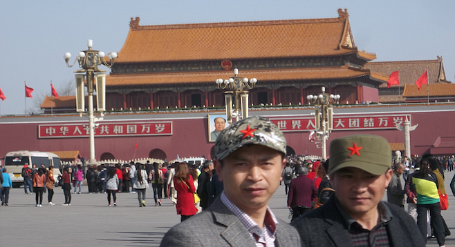 Locals pose for a shot on Tiananmen Square.