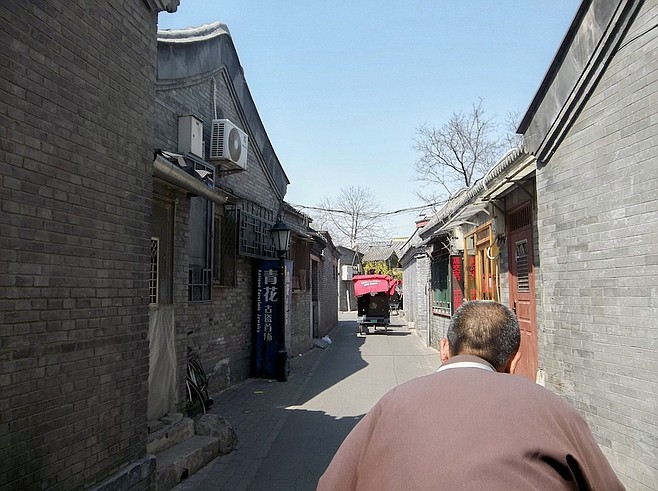 Rickshaw ride through the Beijing hutong.
