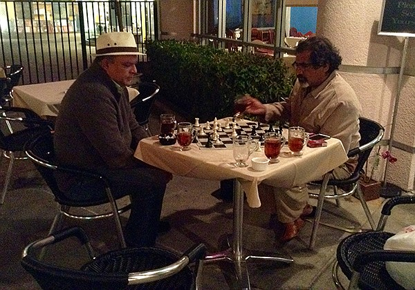 Fieq the philosophy professor plays late-night chess with a fellow customer