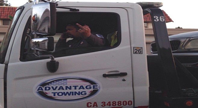Tow-truck driver salutes a passerby