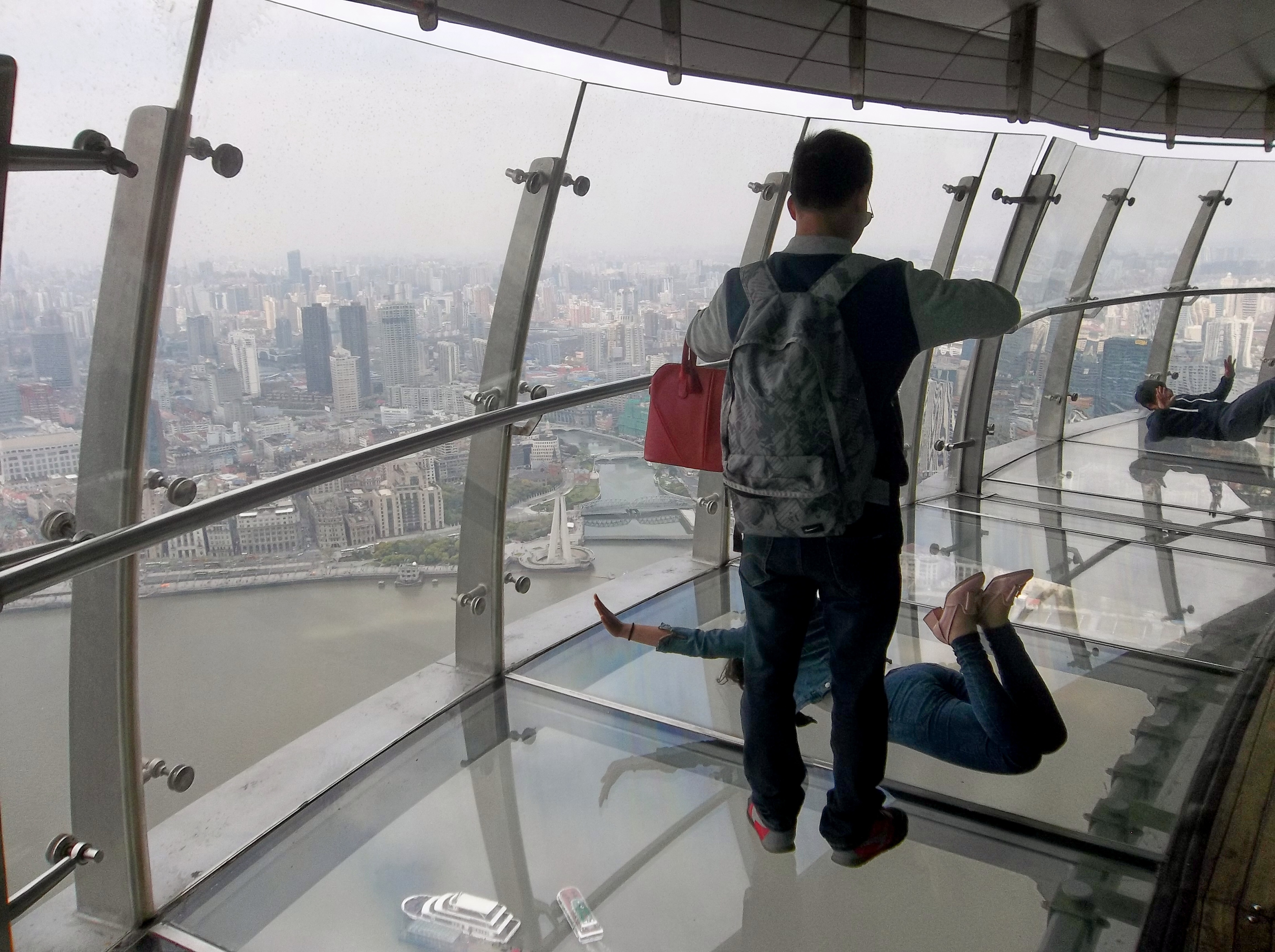 Having fun with the transparent floor at the Oriental Pearl Tower observation deck, Shanghai